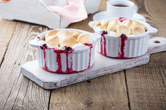 Blackcurrant apple crumble pie with marshmallow on top  in ramek Royalty Free Stock Images