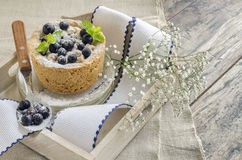 Blackcurrant crumble decorated with mint and berries Stock Image
