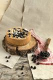 Blackcurrant crumble on wooden stump Royalty Free Stock Image