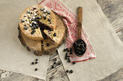 Blackcurrant crumble on wooden stump, view from top Royalty Free Stock Photo