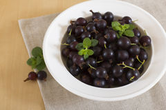 Blackcurrant on a white plate. Healthy food for immunity strengthening Royalty Free Stock Image