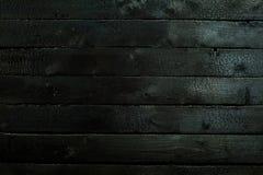 Blacked brände till kol wood panelbakgrundstextur arkivfoton