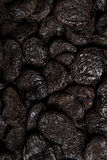 Blackened dried apricots. Close up of aged, dried apricots. Turned from orange to black. Oxidised / oxidation. Texture / overlay Royalty Free Stock Photo