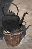 Blackened Kettle on a Fire Pot Stock Images