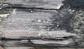 A blackened piece of wreckage. A close up of wreckage, found on the beach Stock Photo