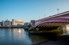 Blackfriars bridge across Thames River and Unilever House early in the morning. London, Great Britain Royalty Free Stock Photos