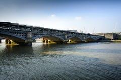 Blackfriars Bridge London. Golden sunlight catches part of the new solar powered station on Blackfriars Bridge across the Thames Stock Photos