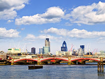 Blackfriars Bridge with London skyline. Behind from Thames river Stock Images