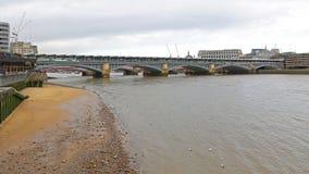 Blackfriars Bridge London. Blackfriars Bridge With Train Station Over Low Tide Thames River in London royalty free stock photos