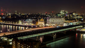 Blackfriars Bridge over the Thames at night. Panoramic view of the river and deserted streets of London far into the night near Blackfriars Bridge Royalty Free Stock Photo