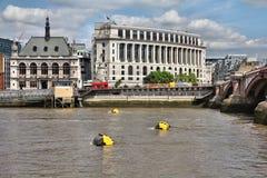 Blackfriars, London. London, UK - Blackfriars area with City of London School (left). River Thames with yellow mooring buoys stock photos