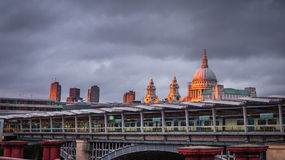 Blackfriars overground station with St Paul Cathedral at dusk. Blackfriars overground train and tube station with St Paul Cathedral dome in the background royalty free stock images