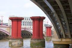 Blackfriars Railway Bridge on the river Thames, London, United Kingdom. Blackfriars Railway Bridge on the river Thames,old red columns, London, United Kingdom Royalty Free Stock Image