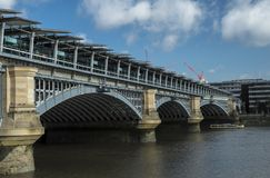 Blackfriars Station and Bridge. Seen from the south side of the River Thames in London on a summer morning Royalty Free Stock Image