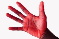 Blackhand dado rojo cogido Imagenes de archivo