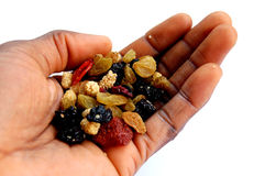 Blackhand and dried berries. This is an image of a black hand and some dried berries royalty free stock photo