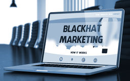Blackhat Marketing Concept on Laptop Screen. 3D. Blackhat Marketing on Landing Page of Mobile Computer Screen in Modern Conference Room Closeup View. Toned Royalty Free Stock Photo