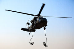 Blackhawk Dropping Ropes stock image