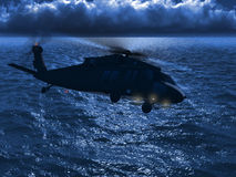 Blackhawk flying sea Royalty Free Stock Photography