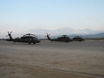 Blackhawk helicopters in Afghanistan. UH-60 Blackhawk helicopters in Mazar-I-Sharif, Afghanistan under the shadow of the Hindu Kush mountains Royalty Free Stock Image