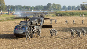 Blackhawk helicopters soldiers Stock Images