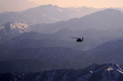 Blackhawk, tramonto, Afghanistan Immagini Stock