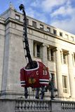 Blackhawks Dinosaur. This is a Spring picture of theField Museum`s outdoor dinosaur dressed in a Blackhawk`s jersey to support the Blackhawks in the Stanley Cup stock images