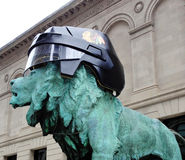 Blackhawks Helmet in Chicago. CHICAGO-MAY 12: A helment was placed on one of the guardian lions at the entrance to the Art Institute in Chicago as a show of royalty free stock image