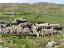 Blackhouse village. A village of blackhouses on the Isle of Lewis (Scotland), with in the vicinity the crofts of its inhabitants stock images