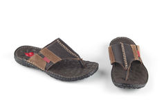 Blackish brown flip flop Stock Images