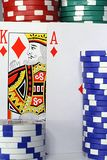 BlackJack. Two stadning cards with poker Chips Royalty Free Stock Images