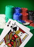 Blackjack!. Player showing Black Jack against a big stack of chips blurred in the background Stock Image