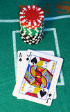 Blackjack. And a stack of chips on a felt background royalty free stock photos
