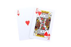 Blackjack. An ace and a king of Hearts isolated on white royalty free stock image