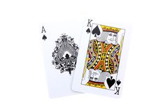 Blackjack. An ace and a king of Spade isolated on white royalty free stock image