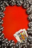 Blackjack Border. Black poker chips on red felt with Blackjack (21) hand royalty free stock image