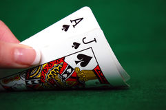 Blackjack Cards. Close up of a hand holding an ace and a jack of spades Stock Image