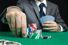 Blackjack in a Casino Gambling Game. Blackjack In A Casino, A Man Makes A Bet, And Puts A Chip Royalty Free Stock Images