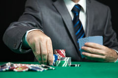 Blackjack in a Casino Gambling Game. Blackjack In A Casino, A Man Makes A Bet, And Puts A Chip Royalty Free Stock Photos