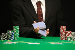Blackjack in a Casino Gambling Game. Casino Worker Holds Deck Of Cards Royalty Free Stock Photography