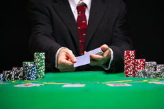 Blackjack in a Casino Gambling Game. Casino Worker Holds Deck Of Cards Stock Photo