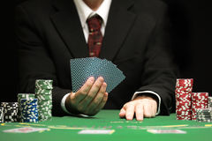 Blackjack in a Casino Gambling Game. Casino Worker Holds Deck Of Cards Stock Photography