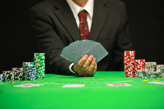 Blackjack in a Casino Gambling Game. Casino Worker Holds Deck Of Cards Stock Photos