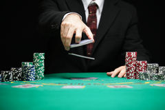 Blackjack in a Casino Gambling Game. Casino Worker Shuffling Deck Of Cards Royalty Free Stock Photo