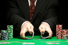 Blackjack in a Casino Gambling Game. Casino Worker Shuffling Deck Of Cards Royalty Free Stock Image