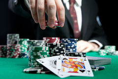 Blackjack in a casino. A man makes a bet, and puts a chip Stock Images