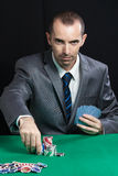 Blackjack At Casino. A Man Makes A Bet, And Puts A Chip Royalty Free Stock Images