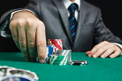 Blackjack In A Casino, A Man Makes A Bet. And Puts A Chip Stock Image