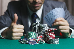 Blackjack In A Casino Man Wins Gets Rich, Shows A Big Like. Blackjack In A Casino Man With Cards Wins Gets Rich, Shows A Big Like Royalty Free Stock Images