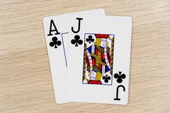 Blackjack - casino playing poker cards. Blackjack - winning hand of gambling casino poker playing cards on a table royalty free stock photography